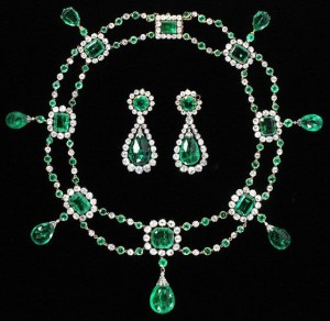 Faceted table-cut emeralds in borders of brilliant-cut diamonds; briolette emerald drops; open-set in gold and silver, 1806