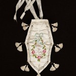 "Reticule, American or English; Early 19th century, 10-5/8""x7-7/8"", silk, satin, metal, embroidery. Museum of Fine Arts, Boston. (Side two.)"