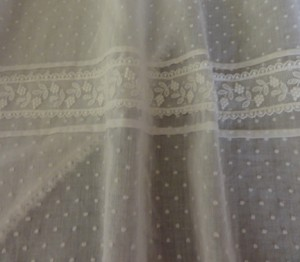 The sheer Swiss dot fabric is so fine, you can see the petticoat lace detail through it.