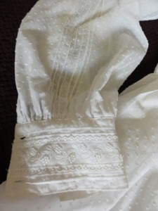 Sleeve detail with lace on cuff and pin-tucks the length of arm.