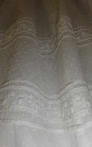 Two rows of Guipure lace and fine pleats on the skirt.