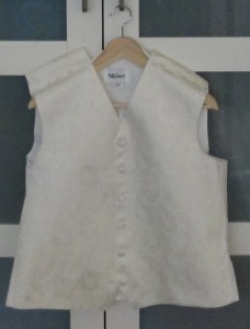 Ivory paisley waistcoat, pinned for the cuts to the shoulders