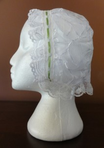 Lace cap, 1.75 inch nails (size small) with lace edge trim.
