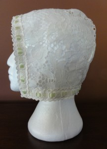 Lace cap, 2 inch nails, no lace edge trim, so fits medium to large.