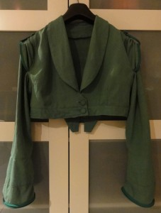 The finished pomona green spencer, with cap sleeves over long sleeves, tied back with a piped band and button from the original blazer.