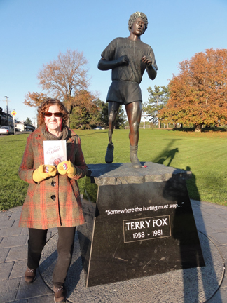 "Author Suzan Lauder and ""Then Comes Winter"" anthology at the Terry Fox memorial statue in Victoria, BC, Canada on November 28, 2015 for the ""Flat Stanley"" book tour."