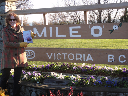 """Then Comes Winter"" stops at Mile Zero of the Trans-Canada Highway on November 28, 2015 as part of the ""Flat Stanley"" book tour. Author Suzan Lauder, with the strait of Georgia in the background."