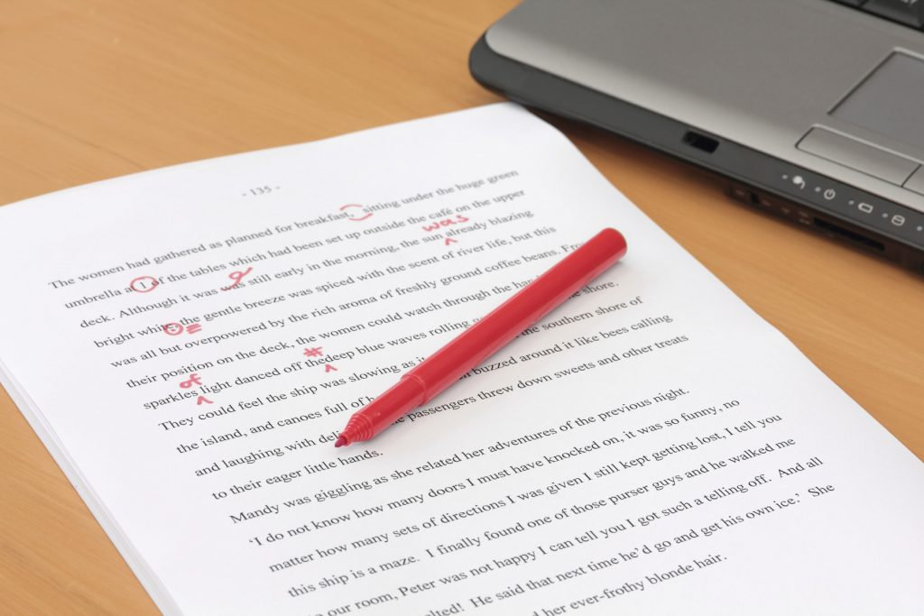 red pen and laptop editing free image smaller